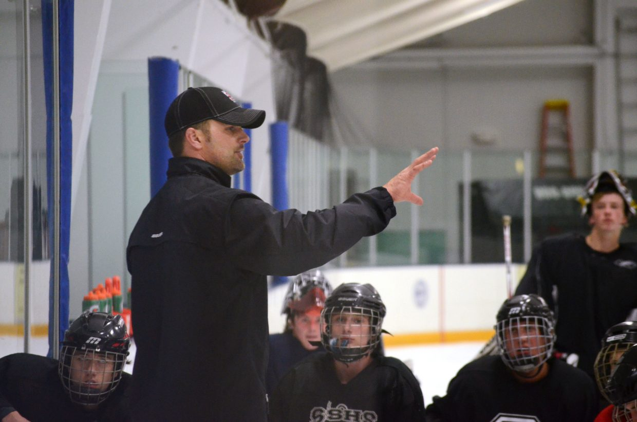 Second-year Sailors hockey coach Brent Tollar addresses his team during a break at Monday's practice at Howelsen Ice Arena. Steamboat opens its season Friday at Battle Mountain.