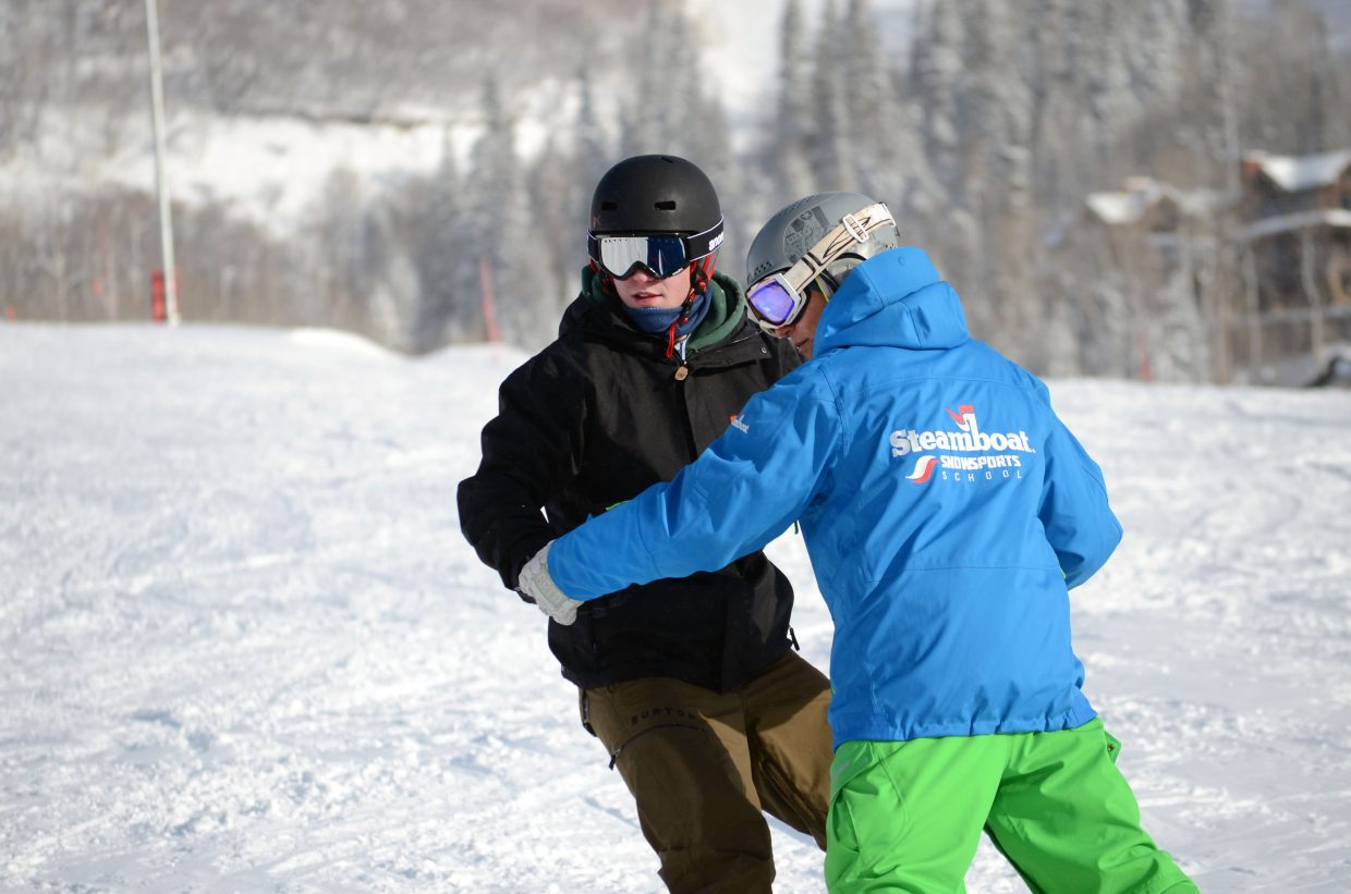 Sometimes it takes a helping hand to get down the mountain when you're a beginner snowboarder. Frustration can settle in for the learner, but a patient instructor like Danny Pinegar, right, can make all the difference.
