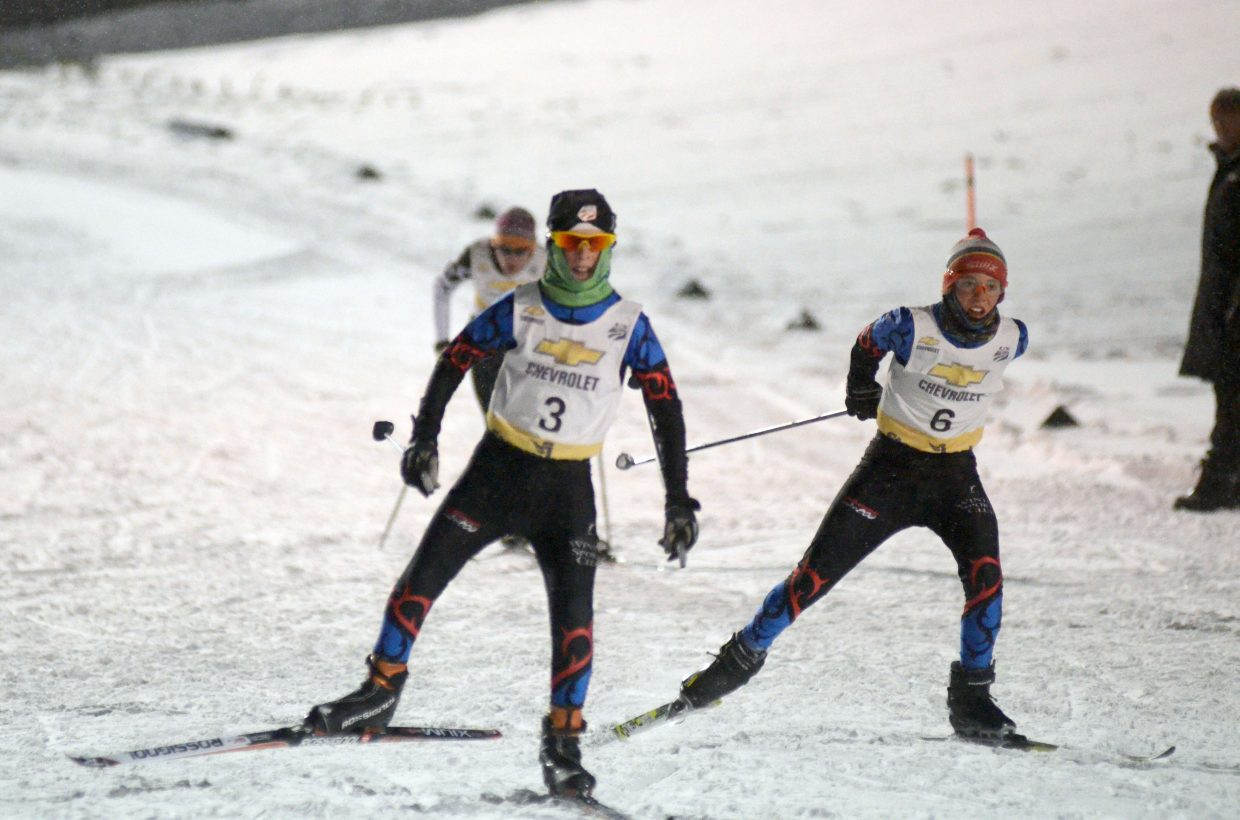 Elijah Vargas, 6, gains ground on Decker Dean, both members of the Steamboat Springs Winter Sports Club, during Saturday's 5-kilometer cross-country race. Elijah edged out Decker, and the duo finished sixth and seventh, respectively.