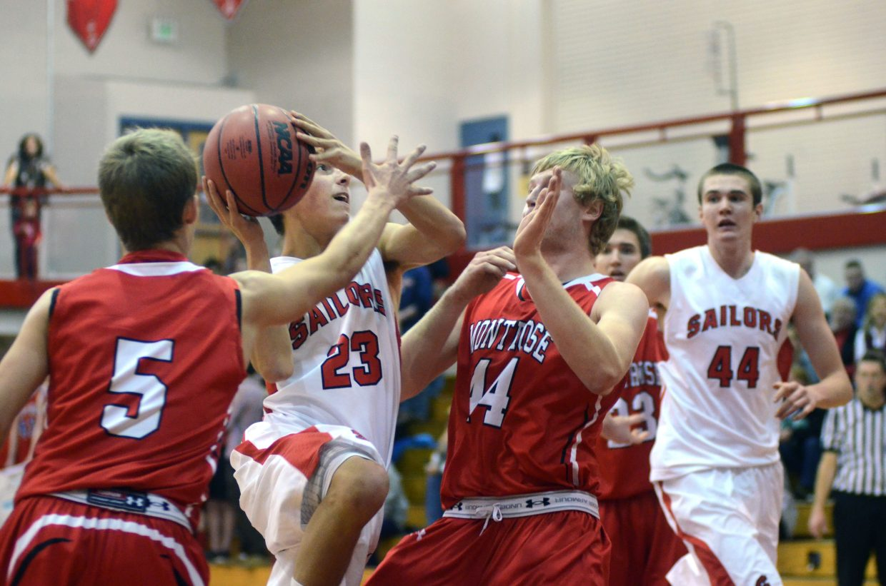 Steamboat senior Zach Dunklin drives to the hoop in the fourth quarter of the Sailors' home tournament win over Montrose on Friday night. Dunklin finished with four points.