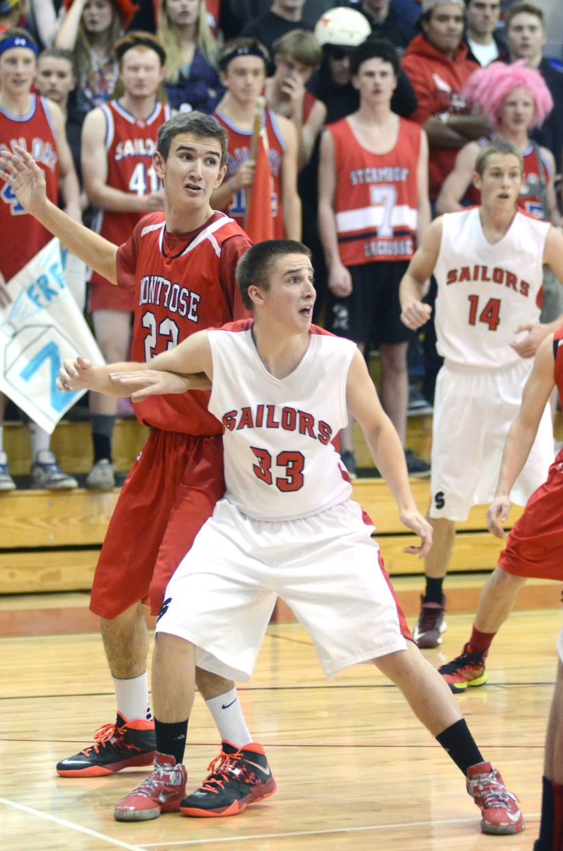 Sailor Jordan Frye boxes out Montrose's Kyle Freeburg in Steamboat's 68-55 win Friday night.