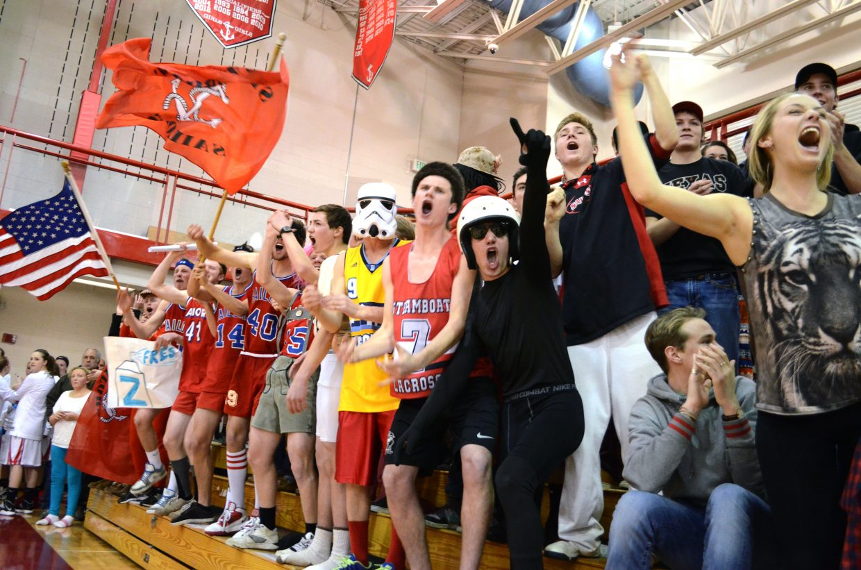 The Steamboat student section goes nuts after junior Garrett Bye's fourth-quarter dunk that gave the Sailors a 57-47 lead late in Friday night's win over Montrose.