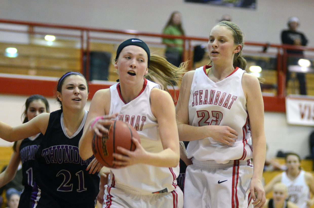 Senior Maggie Crouch pulls down a rebound in the third quarter of Friday's home win for Steamboat.