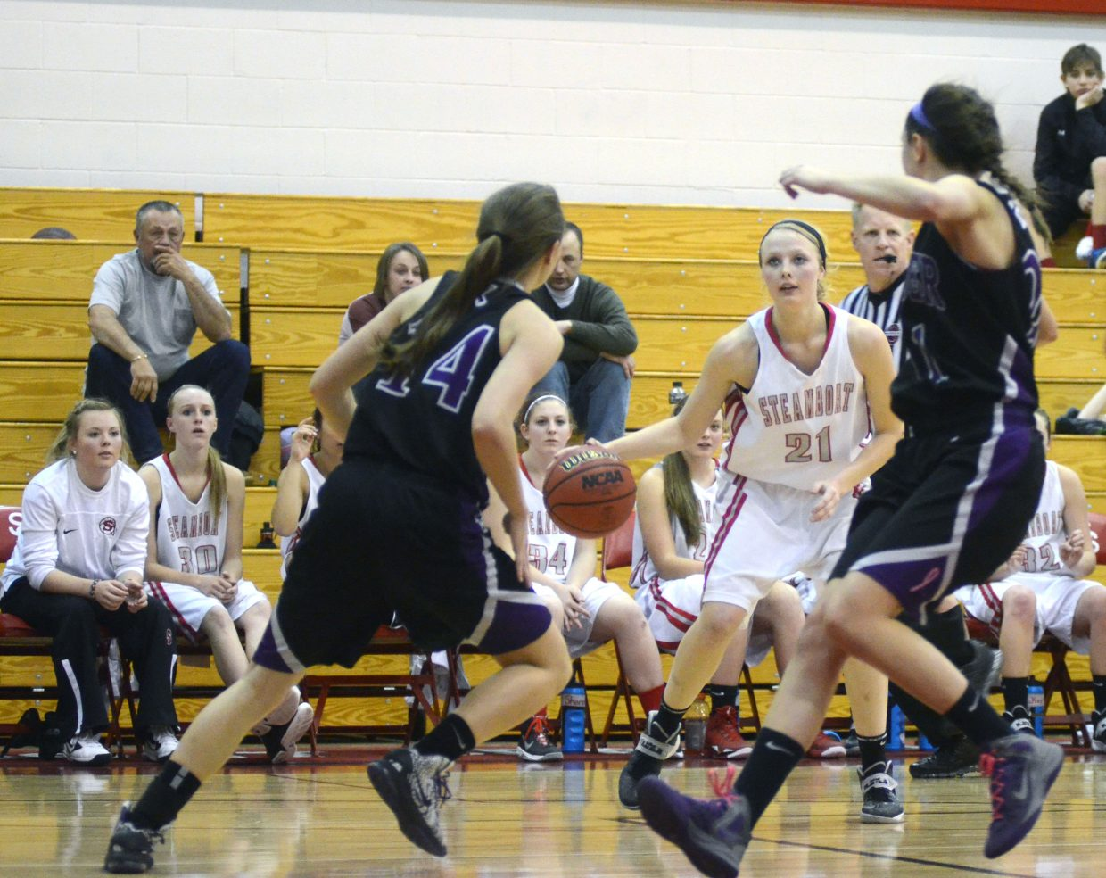 Mikaila Jegtvig looks for a shot between two Discovery Canyon defenders late in the Sailors' 30-27 win Friday night during the Steamboat Shoot-Out.