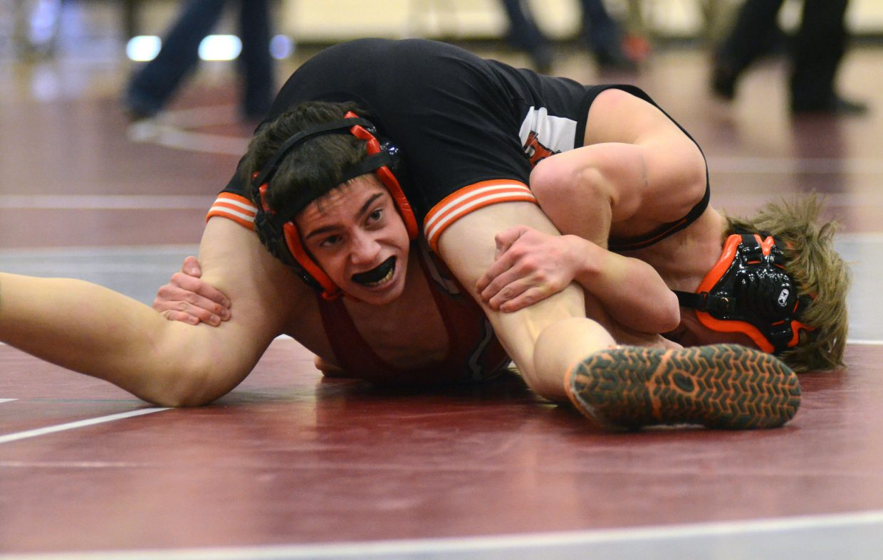 Steamboat Springs wrestler Ethan Labriola, bottom, tries to get away from the grasp of Hayden's Tyler Hockaday. Hockaday won the match, 13-2, at the Soroco Invitational on Saturday.