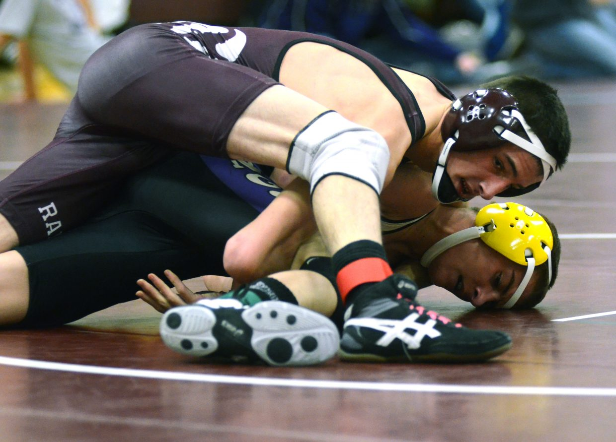 Rams wrestler Colton Martindale traps West Grand's Antonio Corrales during their second-round match at the Soroco Invitational on Saturday. Martindale dominated the match, beating Corrales, 14-2, at 126 pounds.