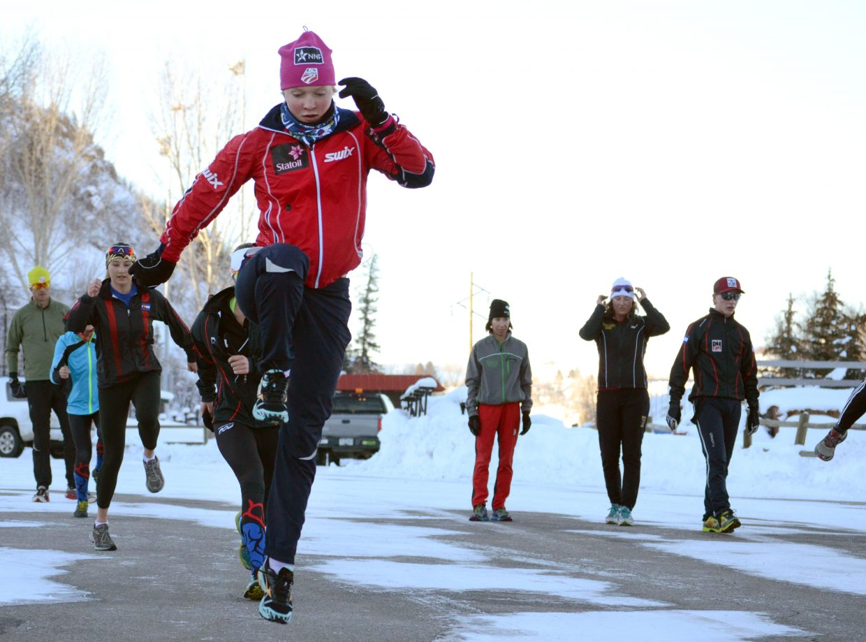 Steamboat Springs Winter Sports Club's Emily Hannah trains with her teammates Friday afternoon in the shadows of Howelsen Hill for the upcoming U.S. Cross-Country Championships at Soldier Hollow in Midway, Utah.