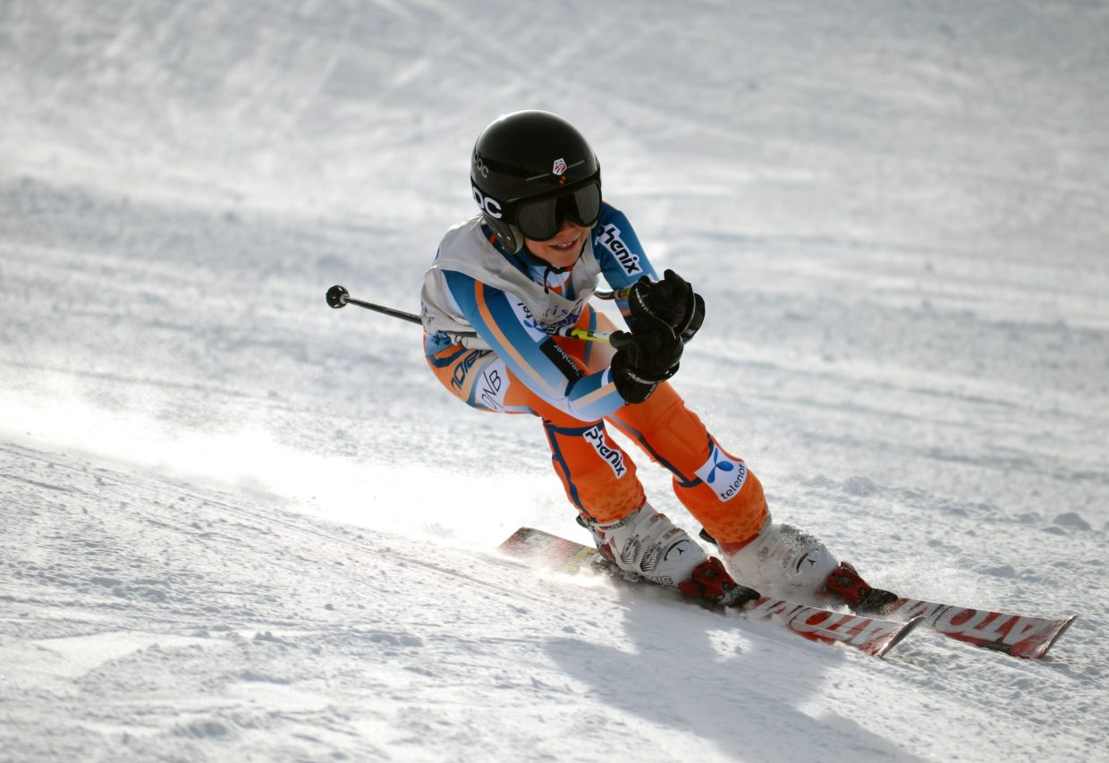 Beck Kuhlmann, 11, races down the giant slalom course Saturday at Steamboat Ski Area for his second run of the Steamboat Cup.