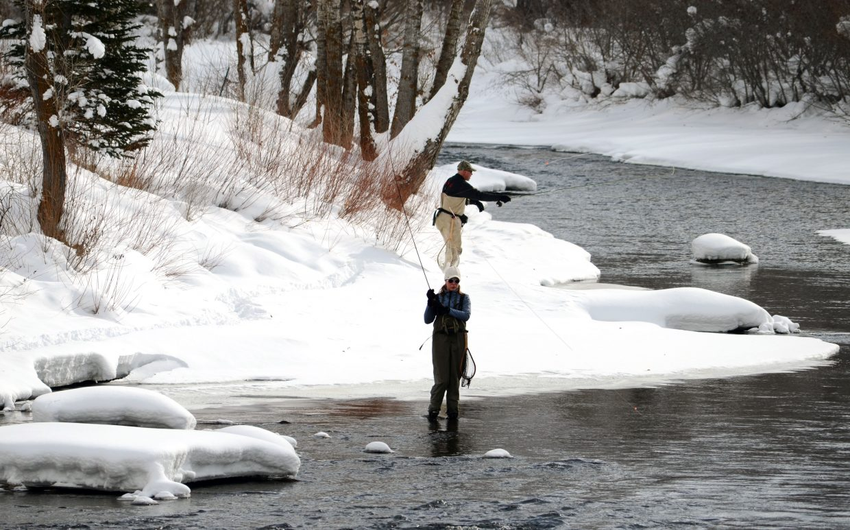 Mark and Taylor Elliott, of Steamboat Springs, brave the frigid temperatures Sunday morning fly-fishing on the Yampa River downtown. Much of the downtown Yampa is frozen or difficult to access, but local fishing guides say business is booming south of town.