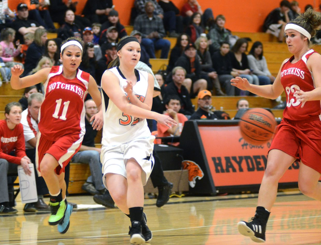 Tigers sophomore Olivia Zehner tries to thread a pass inside during the second quarter of Haydens' 69-29 loss to Hotchkiss on Friday night.