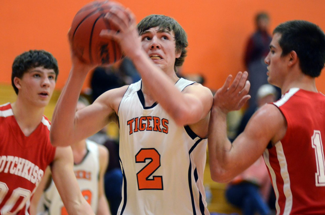 Hayden's Greg Frentress looks for a shot over Hotchkiss' River Panish on Friday night in the Tigers' 15-point loss, their ninth on the season.