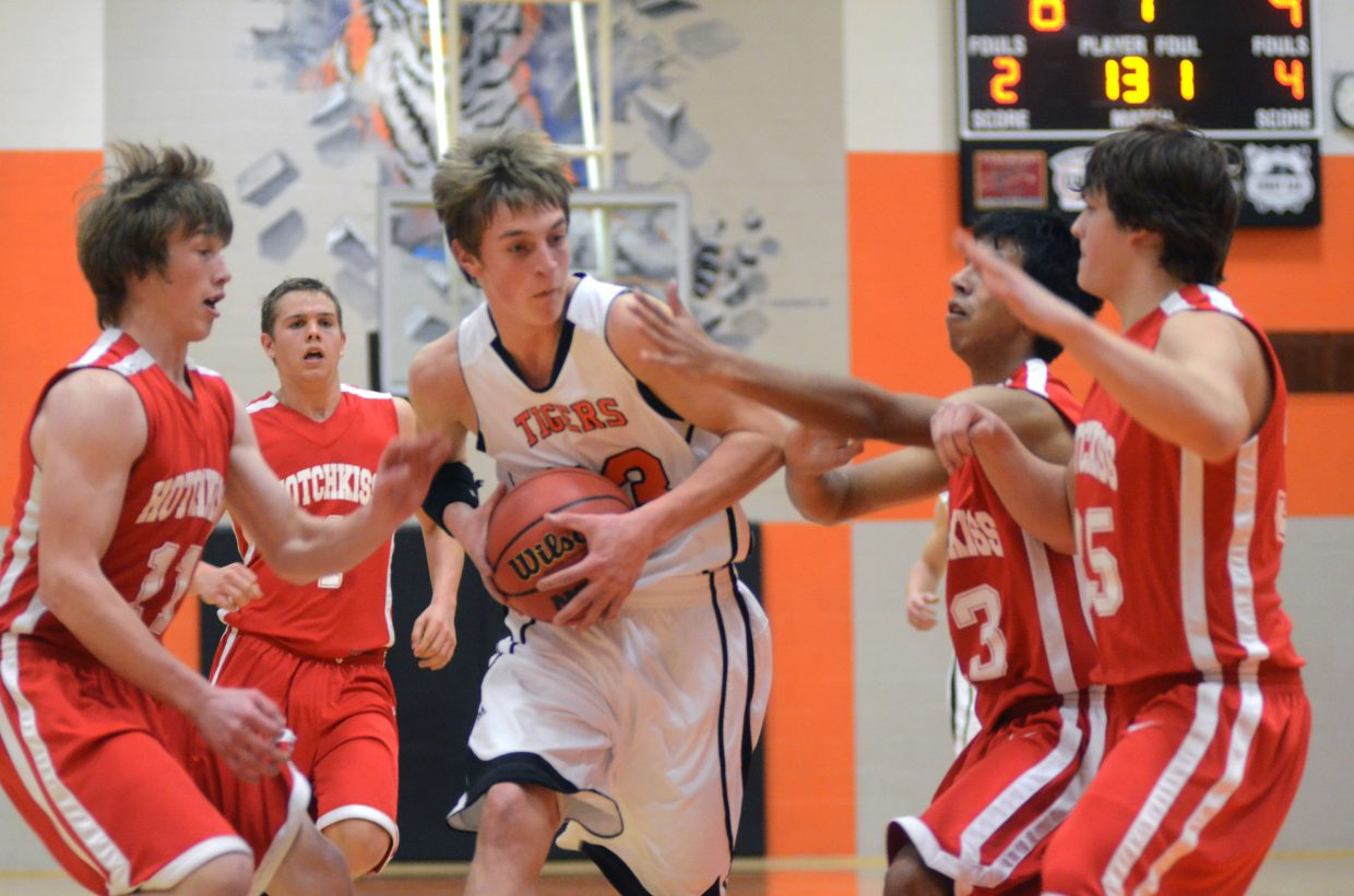 Tigers senior Isaac Bridges tries to split three Hotchkiss defenders Friday night in Hayden's loss. Bridges led all scorers with 22 points.