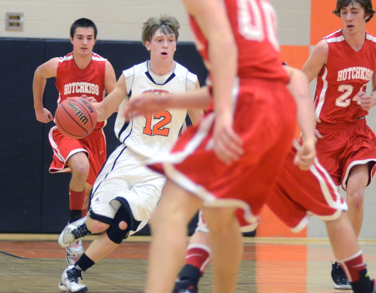 Dan Engle, 12, leads a fast break in the second quarter of Hayden's 59-42 loss to Hotchkiss on Friday night.