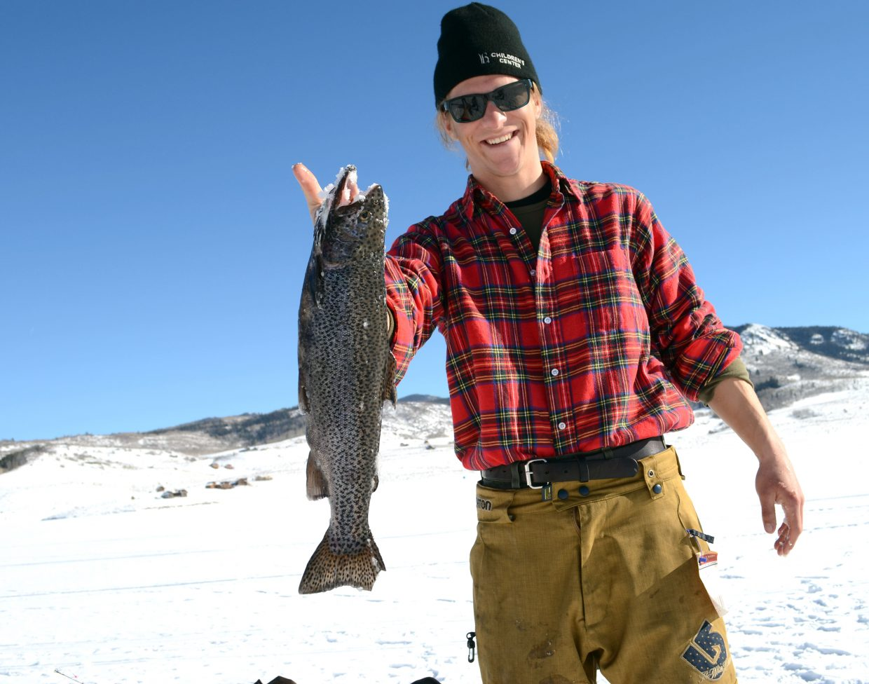 Steele Lewis shows off his final catch of the day at the Steamboat Great Outdoors Ice Fishing Tournament on Sunday at Stagecoach Reservoir.