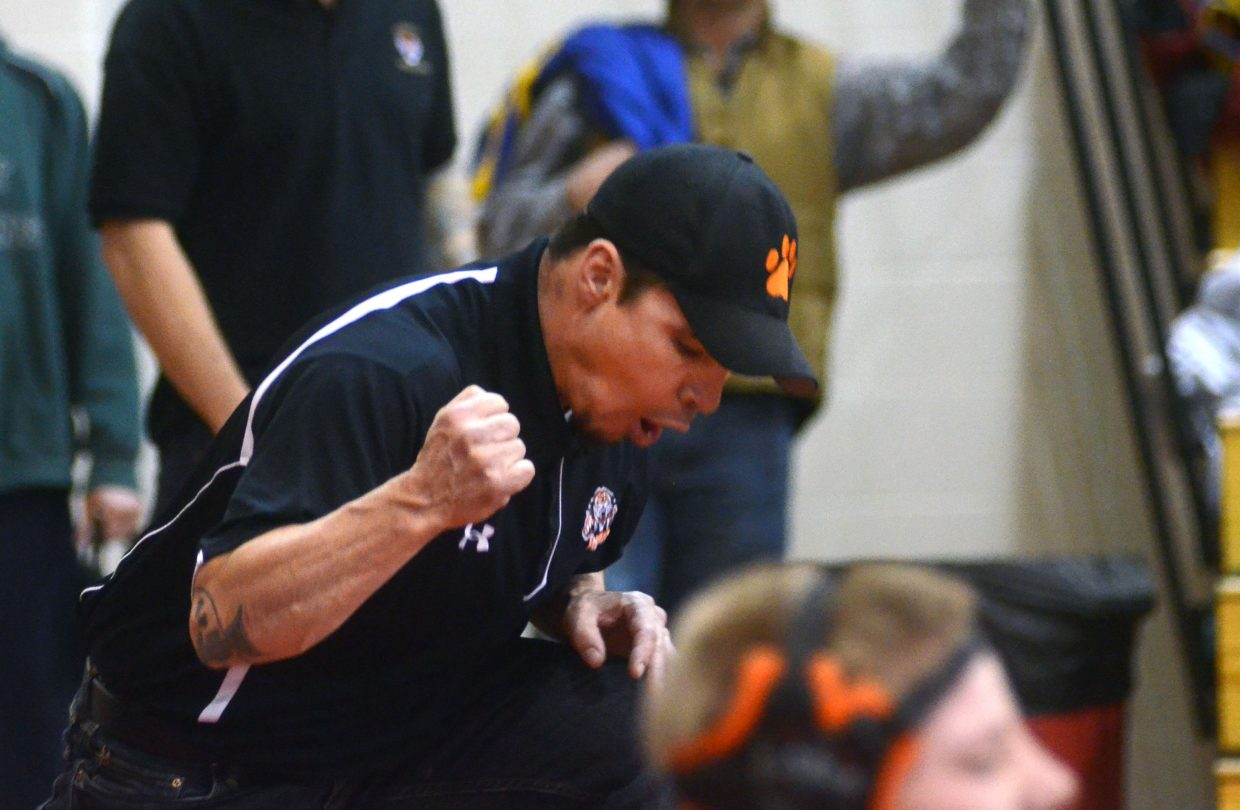 Hayden High School wrestling coach Chad Jones pumps his fist after Michael Ferrier's third-place finish at 113 pounds.