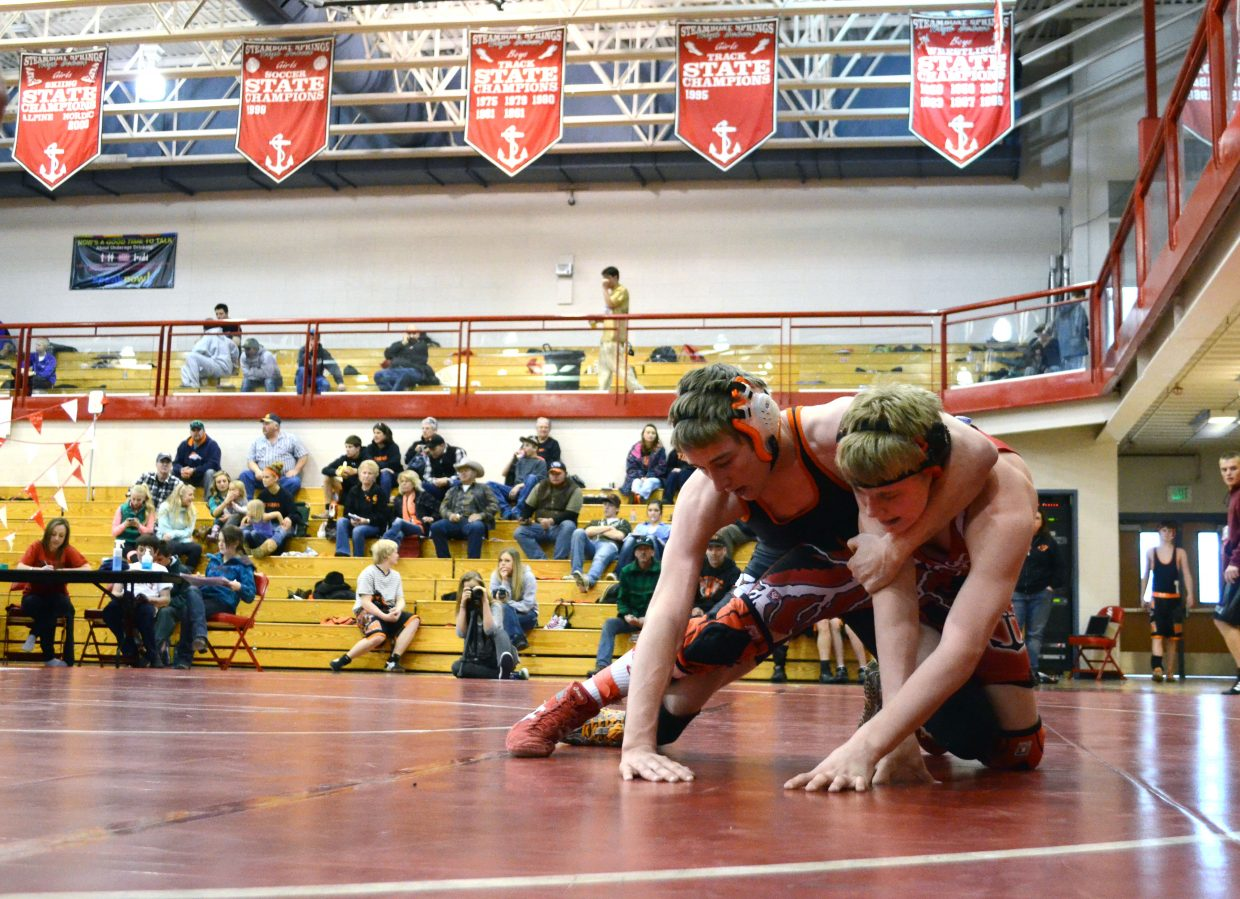Hayden's Kent Miller, left, wrestles with Steamboat's Gage Reynolds during the fifth round of the Carl Ramunno Invitational on Saturday. Miller would go on to win the match.