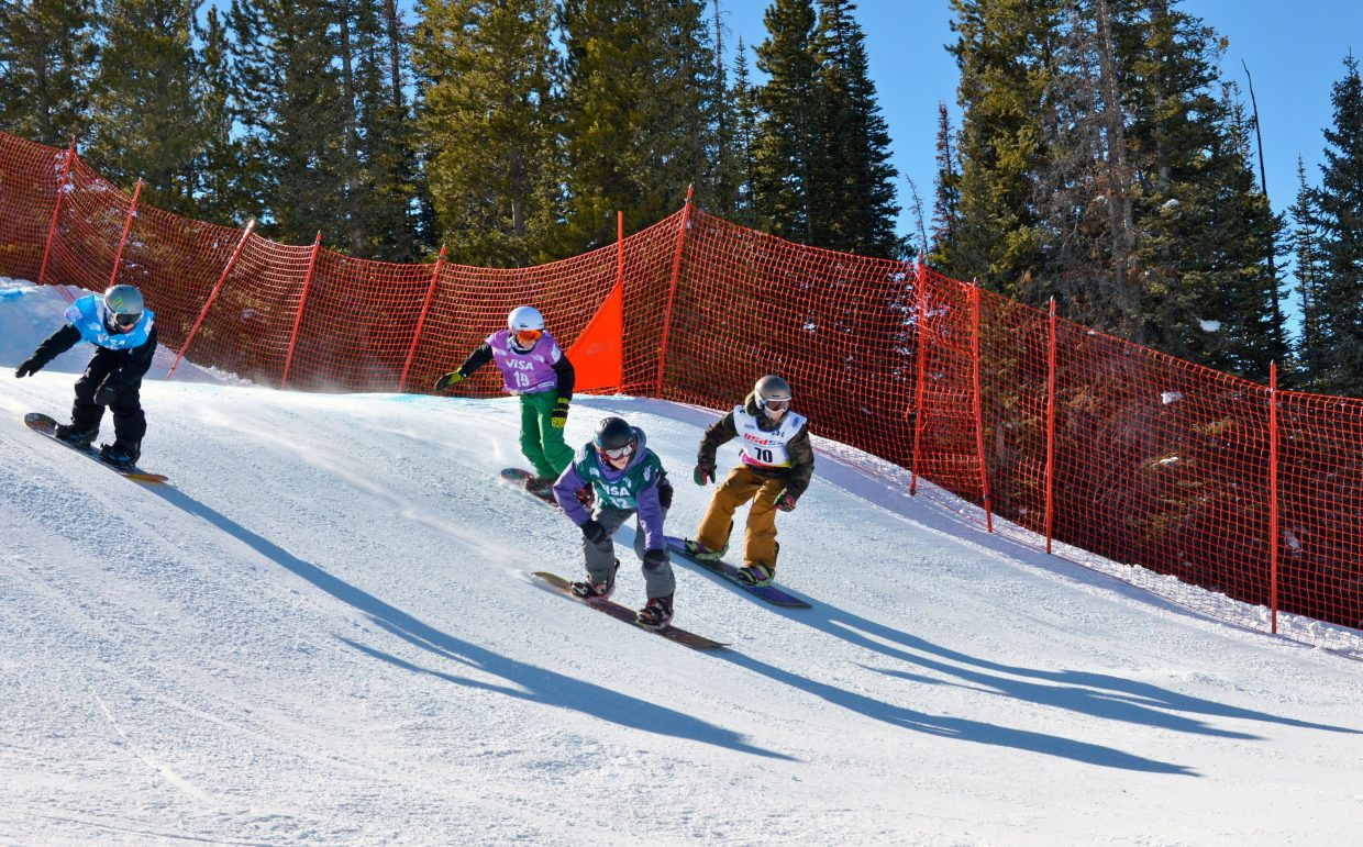 From left, SSWSC snowboarders Winston Vaughan, Ben Larsen (green pants), Cody Winters and Ryan Merritt lead the pack. The four would sweep the breaker boys boardercross division on Sunday.