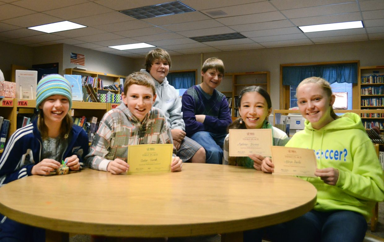 Middle school math team students, from left, Katie Lake, Cedar Turek, Quinn Keefe, Mac Moody, Madison Truong and Alexa Paoli on Monday found out their scores on the AMC 8 math test, which they took in November. Cedar earned his spot among the top 1 percent in the world with his score of 22 out of 25.