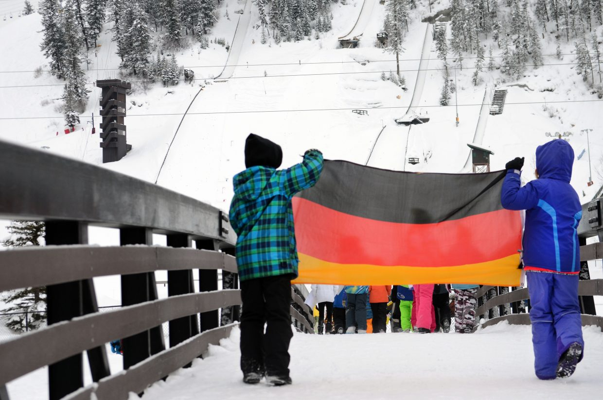 A pair of Soda Creek Elementary School students display the German flag as they march toward Howelsen Hill during the school's rendition of the Parade of Nations.