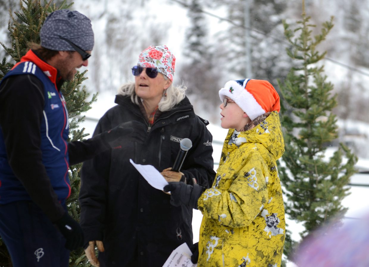 Soda Creek Elementary School student Luke Duksa, right, asks U.S. Paralympics coach Greg Rawlings how his life would be different if he wasn't an Olympian during the school's version of the Parade of Nations Thursday.