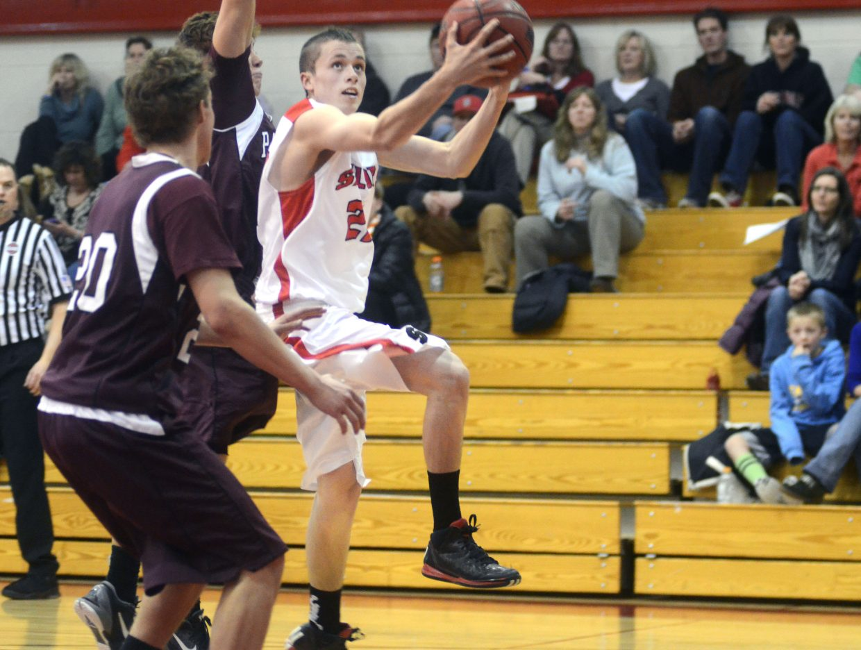 Junior Brody King drives the lane Friday night in Steamboat's home win against Palisade.