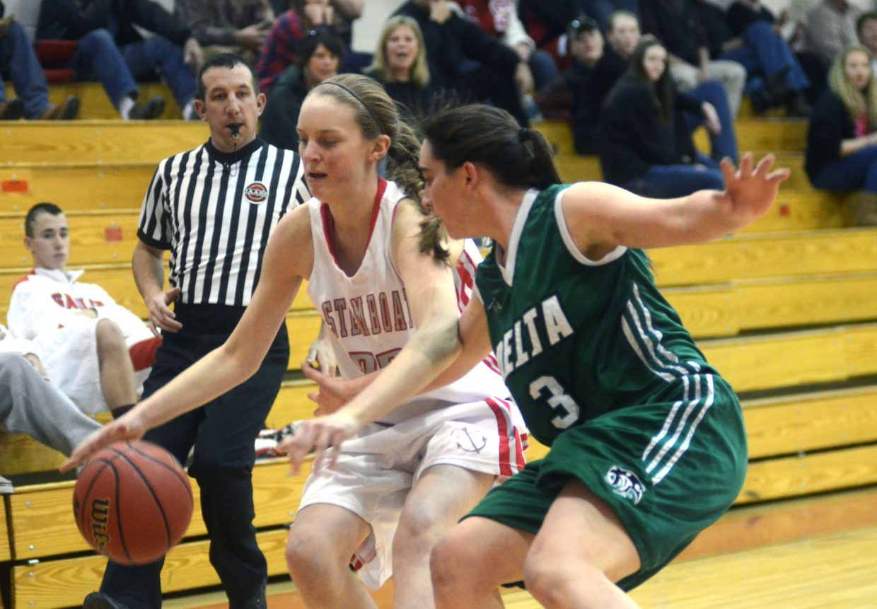 Steamboat's Annie Osbourn tries to evade Delta's Reilly Quist in the first half of the Sailors' 42-36 home loss to the Panthers.