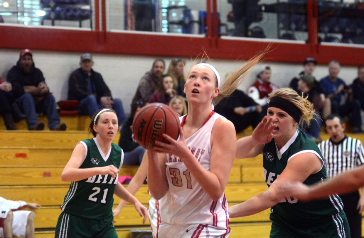 Sailors' Maggie Crouch looks for her shot in Steamboat's six-point home loss to Delta Saturday afternoon. Crouch led all Steamboat players with 14 points.