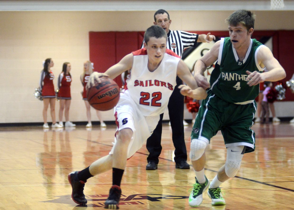 Sailors point guard Brody King tries to drive past Delta's Keaton Reiher in the second half of Steamboat's 66-54 win on Saturday afternoon.