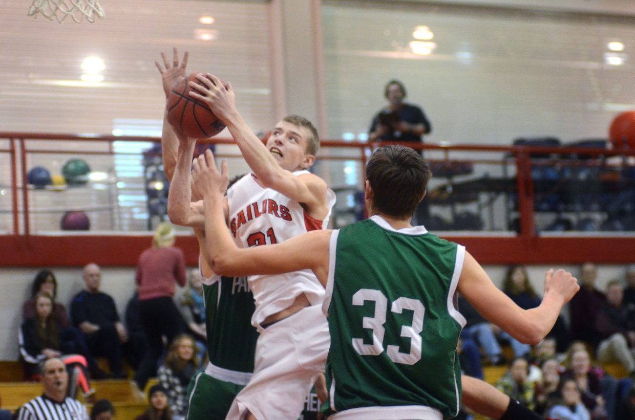 Steamboat's Matthew Lanning gets his shot contested by Delta players in the first half of the Sailors' six-point win over the Panthers on Saturday afternoon.