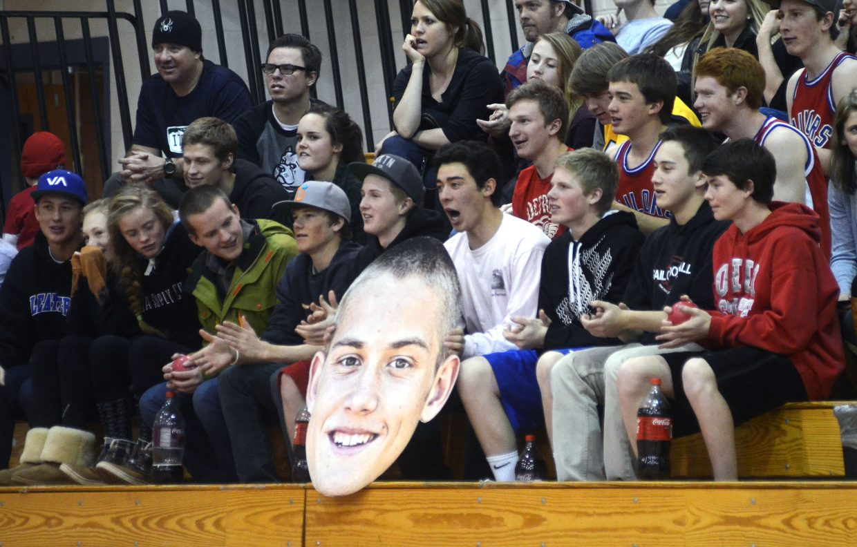 Senior Carter Kounovsky's blown-up mug shot was bouncing around the Steamboat student section Saturday.