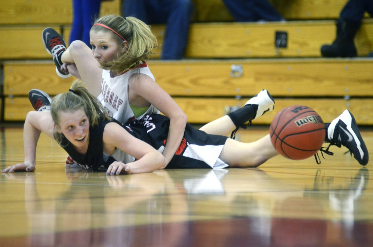 Steamboat senior Hunter Anderson dives for a loose ball over an Eagle Valley player in the Sailors' thrilling 43-41 win on Saturday afternoon.