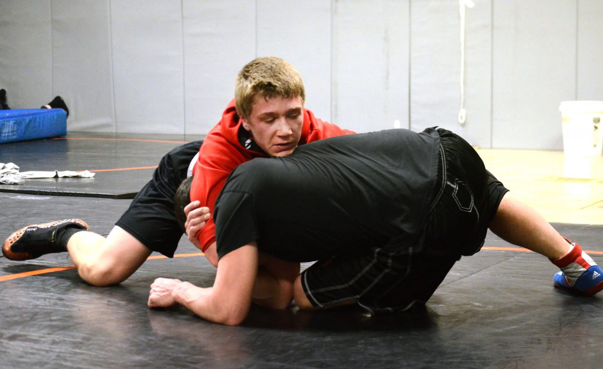 Hayden senior Journey Vreeman tangles with Tigers coach Chad Jones in practice Monday. Vreeman is the team's only senior competing at the state tournament this weekend in Denver.