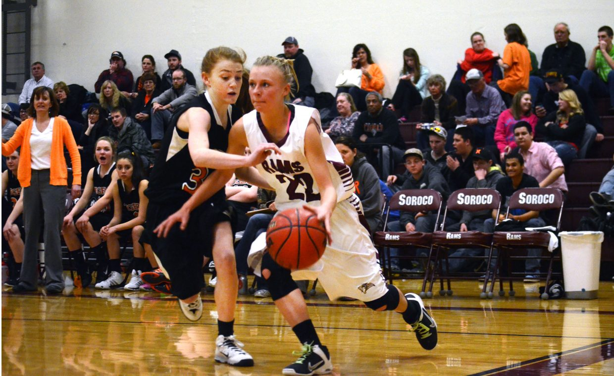 Soroco's Morgan George, right, storms by Hayden's Darian Murphy in the first half of the Rams' 72-48 win Friday night.
