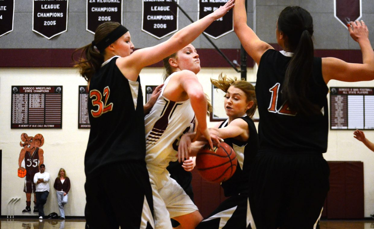Soroco's Jessica Rossi tries to split three Hayden defenders in the Rams' 24-point win Friday night.