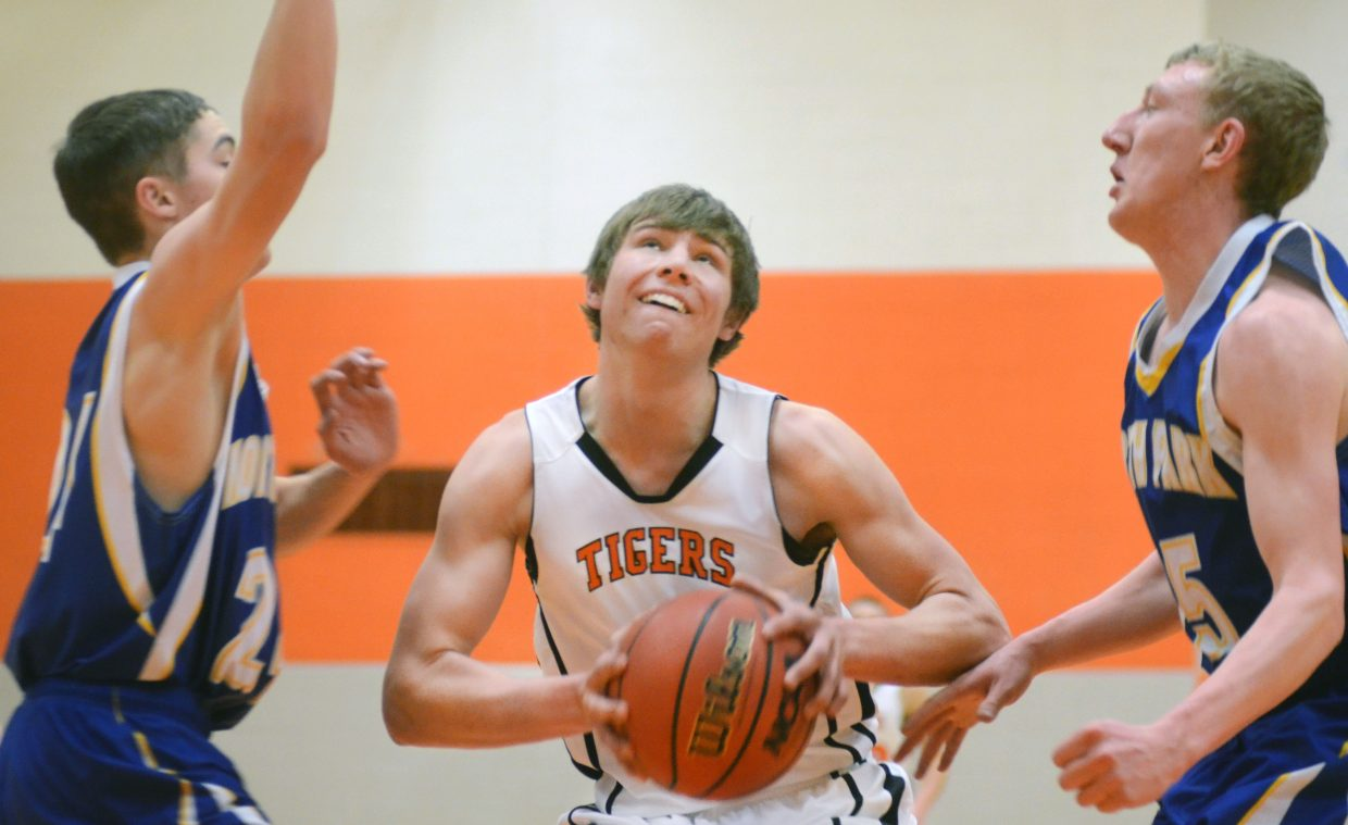 Hayden's Greg Frentress tries to split a pair of North Park players in the first half of the Tigers' 55-49 overtime win Saturday. Frentress scored a game-high 25 points.