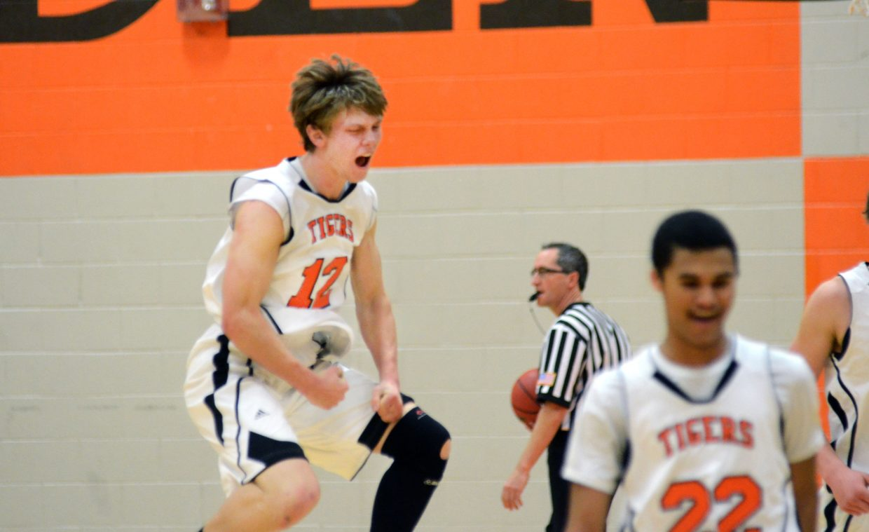 Hayden's Dan Engle, left, celebrates his team's 55-49 overtime win Saturday against North Park. Engle finished with a triple-double, scoring 15 points, grabbing 10 rebounds and dishing out 10 assists.