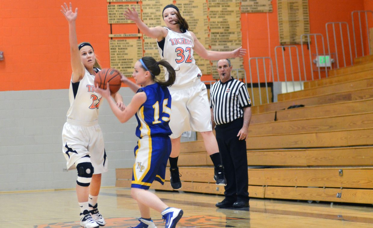Hayden's Jewell Vreeman, left, and Olivia Zehner, right, stifle North Park's Shelby Fliniau in the first half of the Tigers' win Saturday.