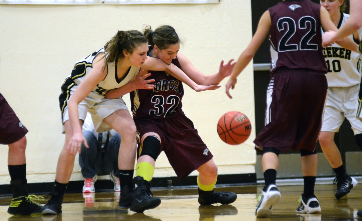 Soroco's Jacey Schlegel, 32, fights for a loose ball against Meeker Friday night in the Rams' 62-45 loss.