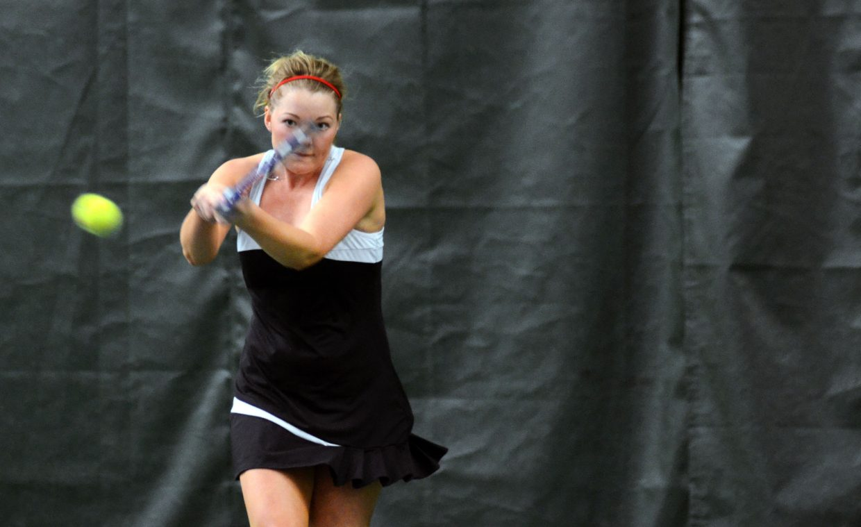 Sailors senior and No. 1 singles player Ellie Bender fires off a return Saturday in her win against Evergreen's Lena Wagner.