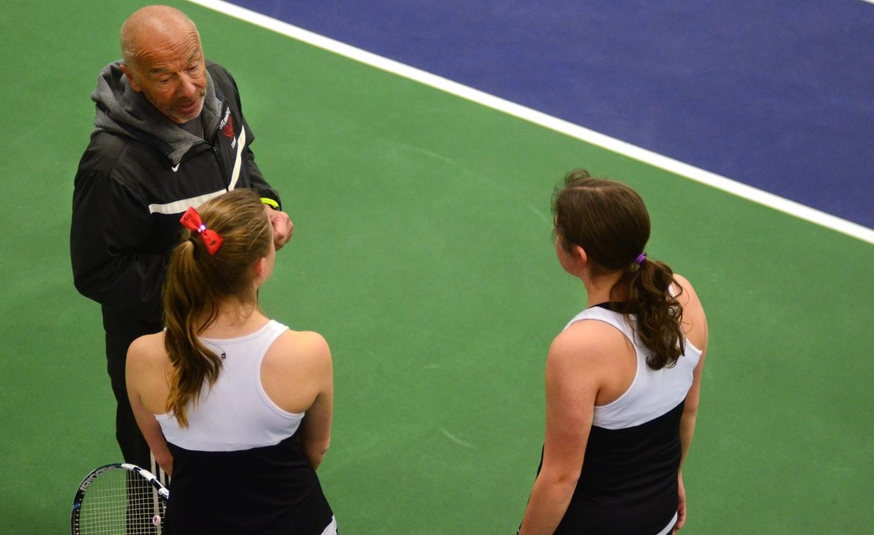 Steamboat assistant coach Don Toy meets with No. 2 doubles team Sabina Berend and Maddie Thompson between sets Saturday.