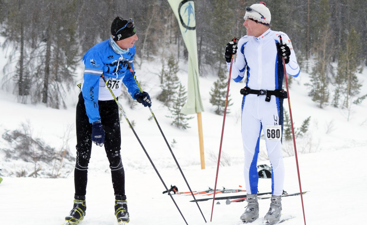 Steamboat Springs Winter Sports Club Nordic coach Brian Tate, left, and James DeFoe catch their breath and discuss the race immediately following their 50K at Saturday's Glide the Divide.