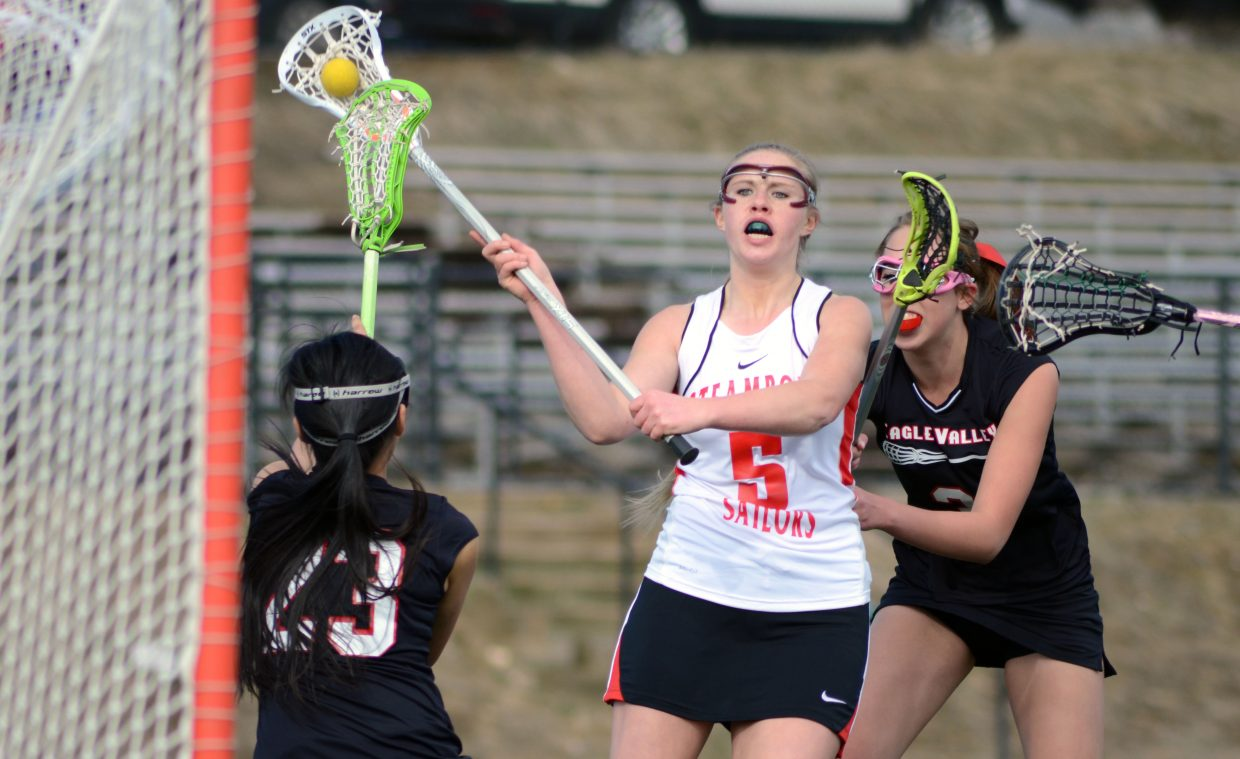 Steamboat's Haley Doyne fires in a shot against Eagle Valley during the Sailors' 10-9 win Friday night, their first of the season.