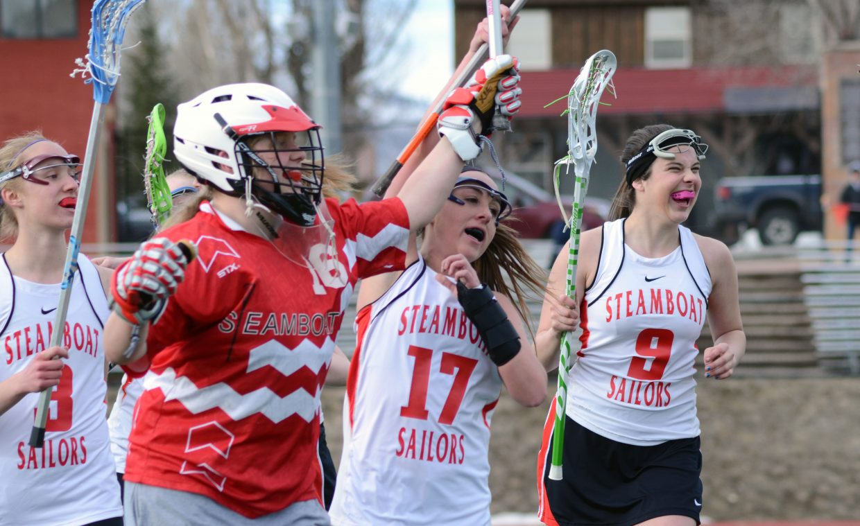 From left, Sailors Abbie Vandergraff, Summer Dorr, Lexy Look and Brittney Starks celebrate their team's 10-9 win against Eagle Valley on Friday night.