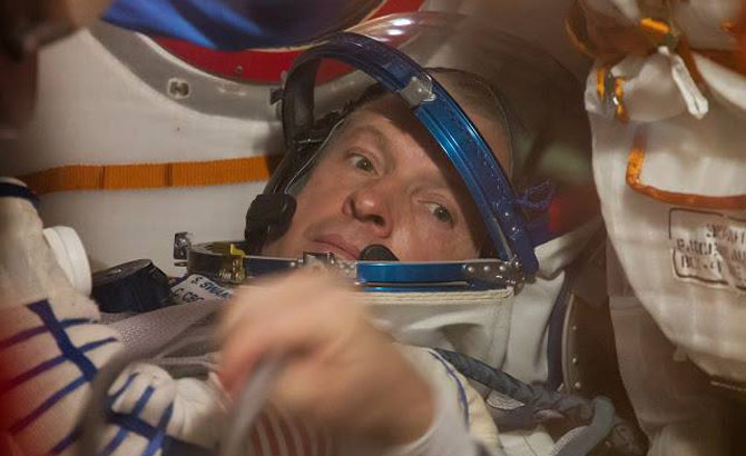 Steamboat Springs High School Class of 1979 graduate Steve Swanson trains inside the Soyuz TMA-12M in preparation for Expedition 39, which launches at 3:17 p.m. Tuesday.