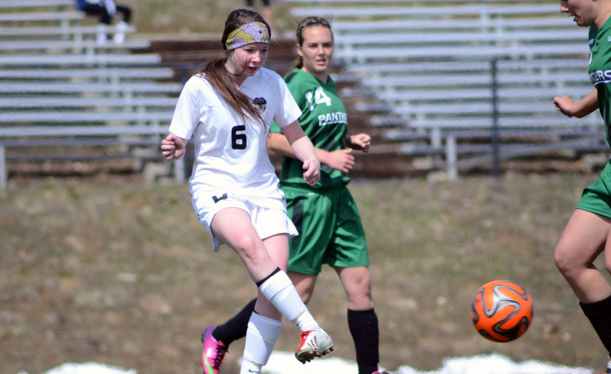 Junior Carolyn Walters, 6, dishes off a pass in the first half of the Sailors' 6-0 win against Delta on Saturday afternoon.