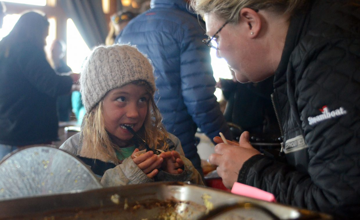 North Routt Community Charter School kindergartner Zeylia Jacobi samples some chili with Brooke Daniel at the 12th annual North Routt Chili Cookoff on Sunday.