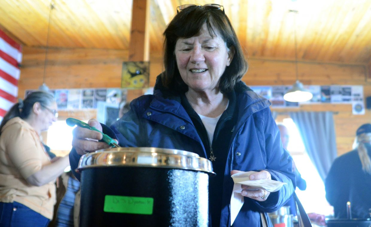 Jodi Meccini, of Steamboat Springs, grabs a ladle full of Di's Dynamite green chili Sunday at the 12th annual North Routt Chili Cookoff at Hahn's Peak Roadhouse.