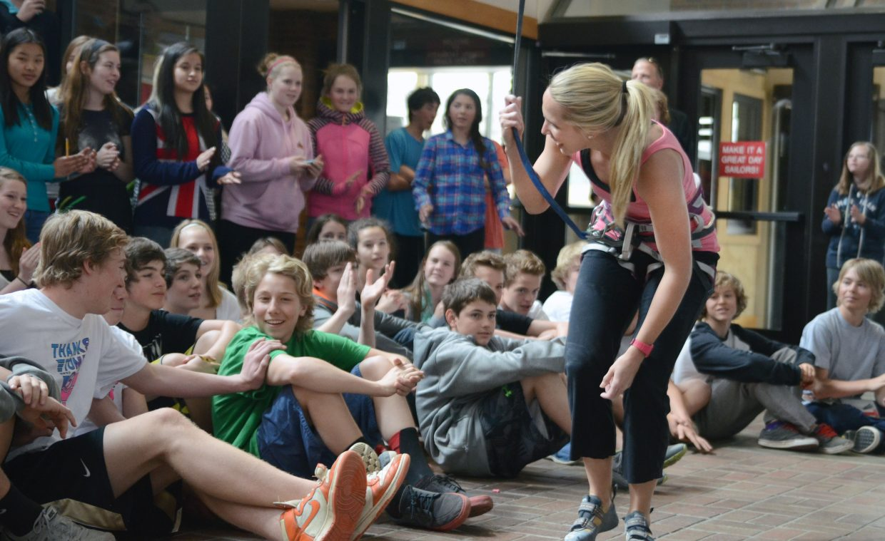 World-record-setting rock climber and Steamboat resident Tori Allen gets a round of applause from Steamboat Springs Middle School students after scaling the campus' climbing wall Thursday. Allen presented her story to eighth-graders as part of the Everything Outdoors Steamboat program.