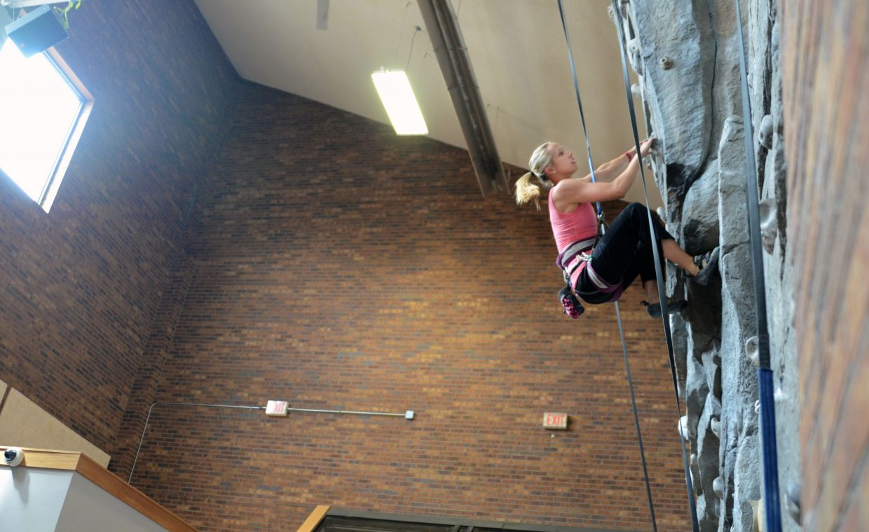 Rock climber Tori Allen speed climbs the Steamboat Springs Middle School wall Thursday during her presentation to eighth-graders as part of the Everything Outdoors Steamboat program.
