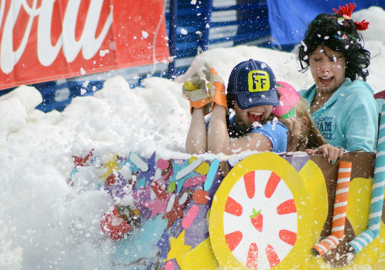 """From left, Sarah Heineke, Leona Thurston and Tori Allen fight off a spray of snow inside their """"Wreck-It Ralph"""" car at the 34th annual Cardboard Classic on Saturday."""